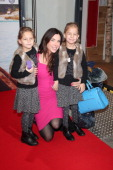 Alexandra Polzin and kids of a friend Paulina and Leni attend the premiere of the film 'Fuenf Freunde 3' at Cinemaxx on January 12 2014 in Munich...