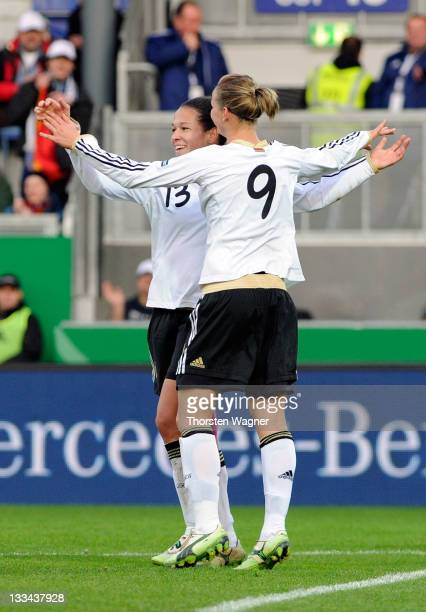 Alexandra Popp and Celia Okoyino da Mbabi celebrates during the Womens's Euro 2013 qualifier group 2 match between Germany and Kazakhstan at...