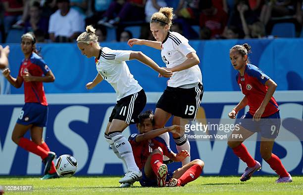 Alexandra Popp and Kim Kulig of Germany fight for the ball with Raquel Rodriguez Cedeno of Costa Rica during the FIFA U20 Women's World Cup Group A...