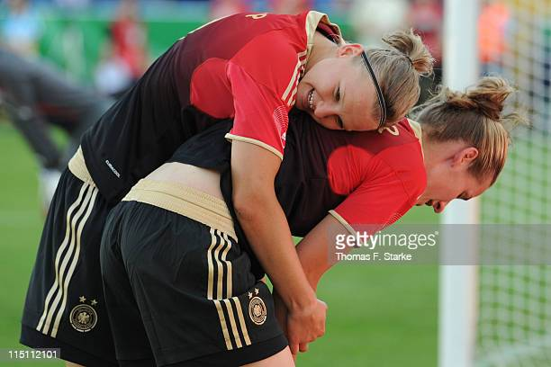 Alexandra Popp and Simone Laudehr of Germany celebrate during the Women's International friendly match between Germany and Italy at the Osnatel Arena...