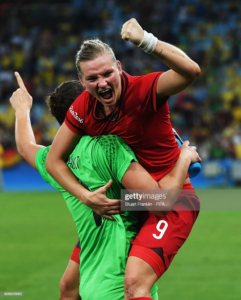 Alexandra Popp celebrates with Almuth Schult of Germany after winning the Olympic Women's Football final between Sweden and Germany at Maracana Stadium on August 19, 2016 in Rio de Janeiro, Brazil.