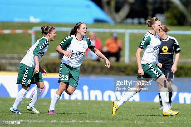 Alexandra Popp of Duisburg celebrates after scoring his team's second goal during the Women's DFB Cup semi final match between 1 FFC Frankfurt and...