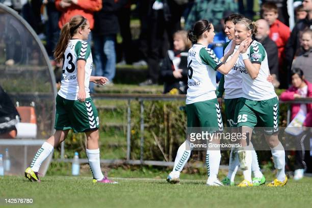 Alexandra Popp of Duisburg celebrates with teammates after scoring his team's second goal during the Women's DFB Cup semi final match between 1 FFC...