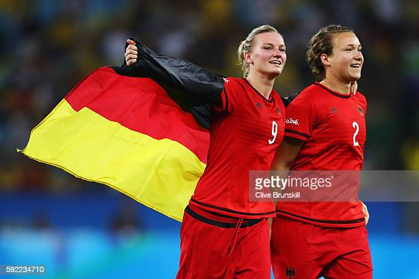Alexandra Popp of Germany and Josephine Henning of Germany celebrate victory at the end of the Women's Olympic Gold Medal match between Sweden and...
