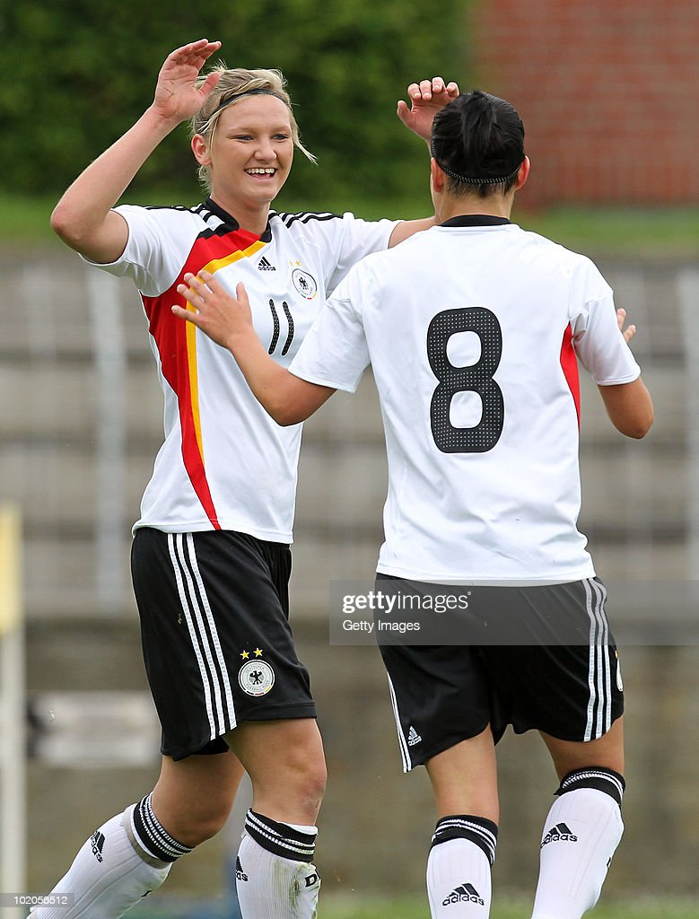Alexandra Popp (L) of Germany celebrates a goal with team mate Selina Wagner (R) during the DFB women's U20 match between Germany and USA at the Ludwig-Jahn-Stadion on June 13 2010 in Herford, Gerrmany.