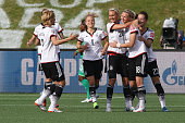 Alexandra Popp of Germany celebrates a goal with teammate Lena Goessling during the FIFA Women's World Cup Canada 2015 Group B match between Germany...