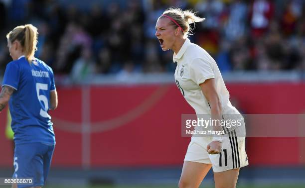 Alexandra Popp of Germany celebrates after scoring her team's first goal during the 2019 FIFA Women's World Championship Qualifier match between...