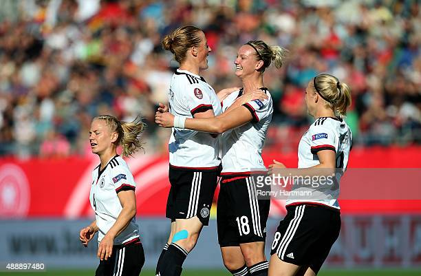 Alexandra Popp of Germany celebrates after scoring her team's opening goal with Melanie Behringer of Germany during the UEFA Women's Euro 2017...