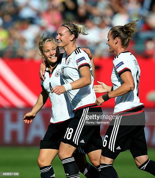 Alexandra Popp of Germany celebrates after scoring her team's opening goal with Leonie Maier and Simone Laudehr of Germany during the UEFA Women's...