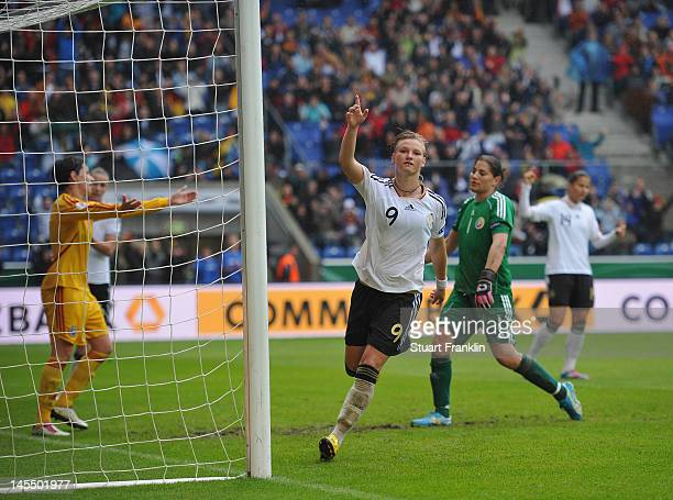 Alexandra Popp of Germany celebrates scoring the fifth goal her third during the UEFA Womens Euro 2013 qualification match between Germany and...