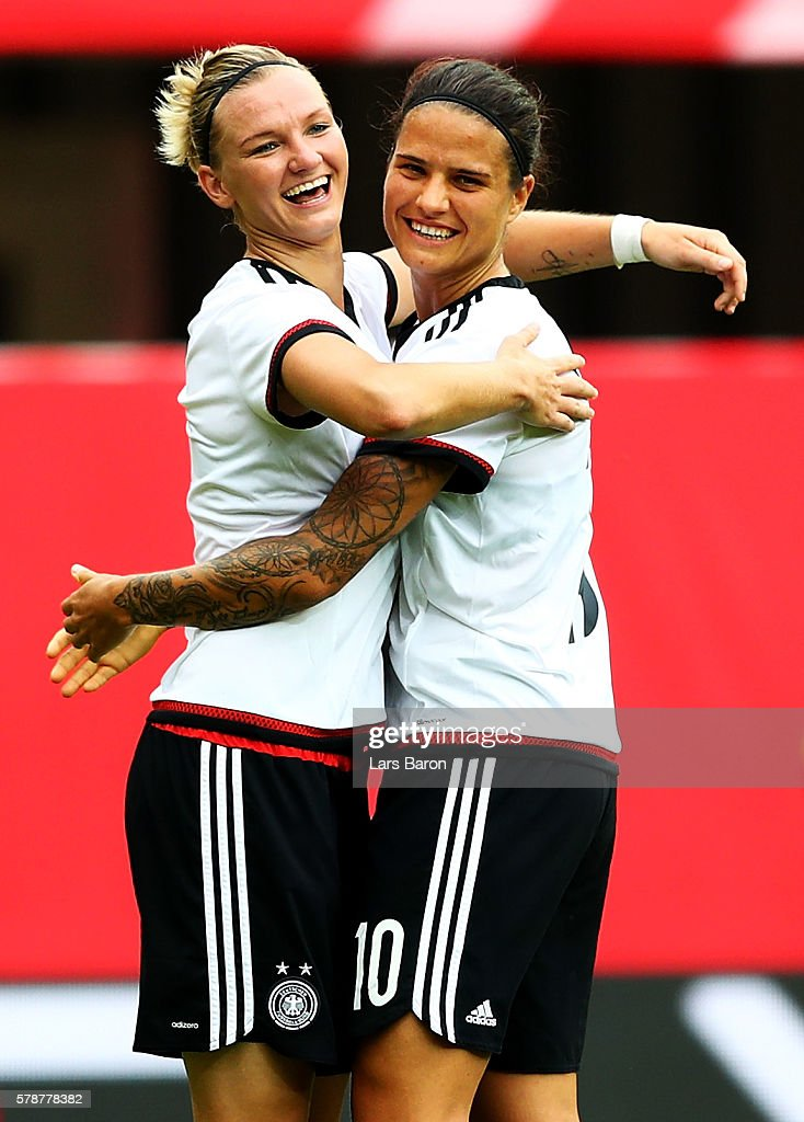 Alexandra Popp of Germany celebrates with Dzsenifer Maroszan of Germany after scoring her teams fifth goal during the women's international friendly match between Germnay and Ghana at Benteler Arena on July 22, 2016 in Paderborn, Germany.