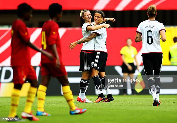 Alexandra Popp of Germany celebrates with Dzsenifer Maroszan of Germany after scoring her teams fifth goal during the women's international friendly...