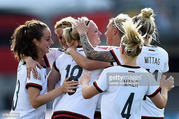 Alexandra Popp of Germany celebrates with team mates as she scores the tenth goal during the FIFA Women's World Cup Canada 2015 Group B match between...