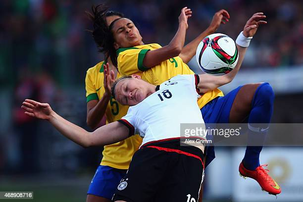 Alexandra Popp of Germany is challenged by Andressa Alves of Brazil during the Women's International Friendly match between Germany and Brazil at...