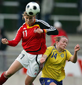 Alexandra Popp of Germany is challenged by Sara Eliasson of Sweden during the Women's U17 Euro qualifier match between Germany and Sweden at the 'Am...