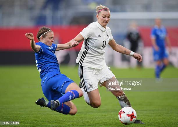 Alexandra Popp of Germany is challenged by Sif Atladottir of Iceland during the 2019 FIFA Women's World Championship Qualifier match between Germany...