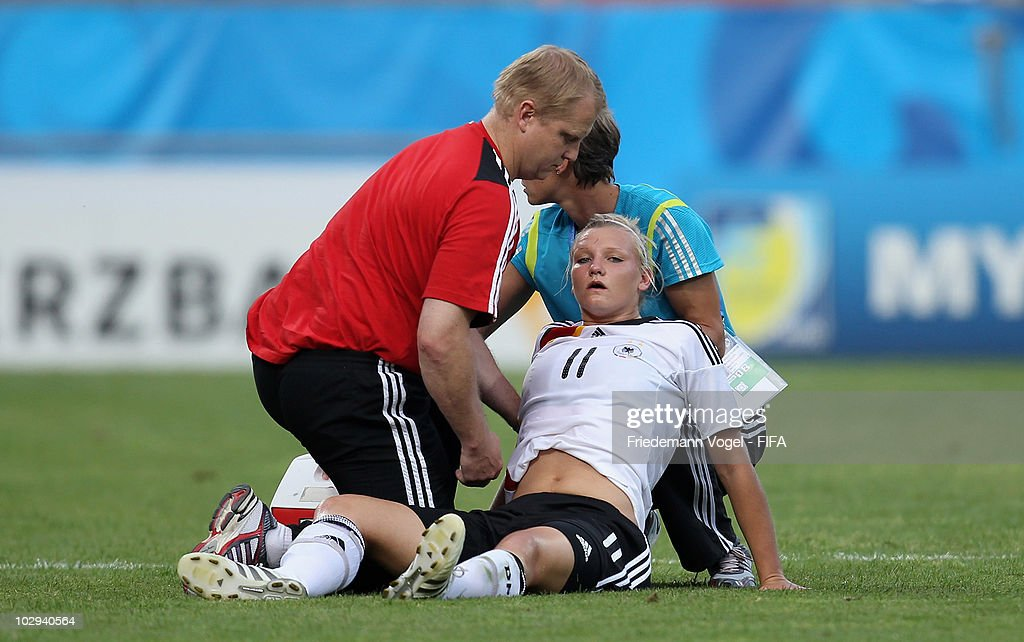 Alexandra Popp (R) of Germany is injured during the FIFA U20 Women's World Cup Group A match between Germany and Colombia at the FIFA U-20 Women's World Cup stadium on July 16, 2010 in Bochum, Germany.