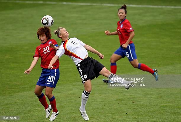 Alexandra Popp of Germany Kim Hye Ri and Jeong Yeonga of South Korea battle for the ball during the FIFA U20 Women's World Cup Semi Final match...