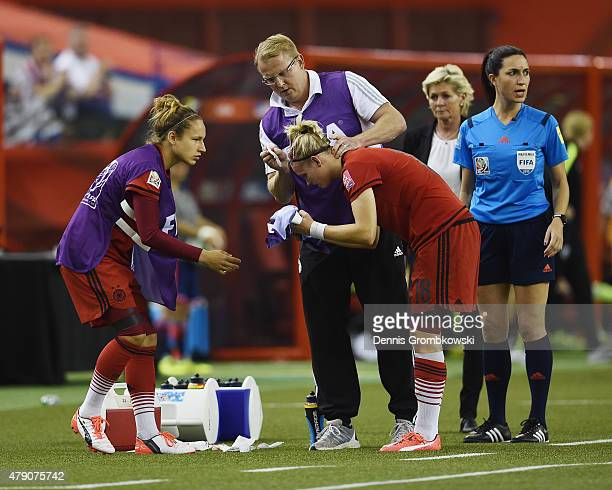 Alexandra Popp of Germany receives medical treatment in the FIFA Women's World Cup 2015 SemiFinal Match at Olympic Stadium on June 30 2015 in...
