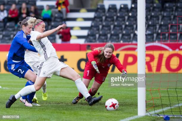 Alexandra Popp of Germany scores her team's first goal past goalkeeper Monika Biskopstoe of Faroe Islands during the 2019 FIFA Women's World...