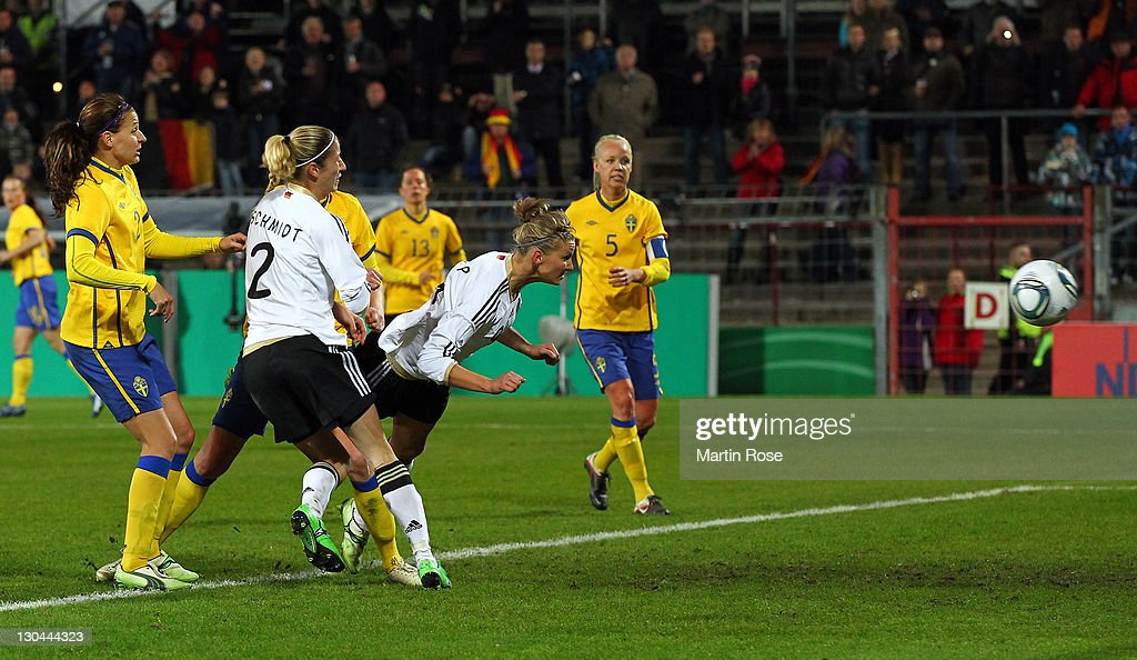 Alexandra Popp (C) of Germany scores her team's opening goal during the Women's International friendly match between Germany and Sweden on October 26, 2011 in Hamburg, Germany.