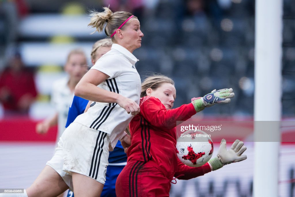 Alexandra Popp of Germany scores her team's sixth goal against goalkeeper Monika Biskopstoe of Faroe Islands during the 2019 FIFA Women's World Championship Qualifier match between Germany and Faroe Islands at mechatronik Arena on October 24, 2017 in Grossaspach, Germany.
