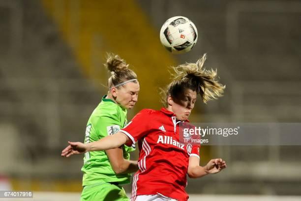 Alexandra Popp of Wolfsburg and Gina Lewandowski of Munich battle for the ball during the Women's DFB Cup Quarter Final match between FC Bayern...