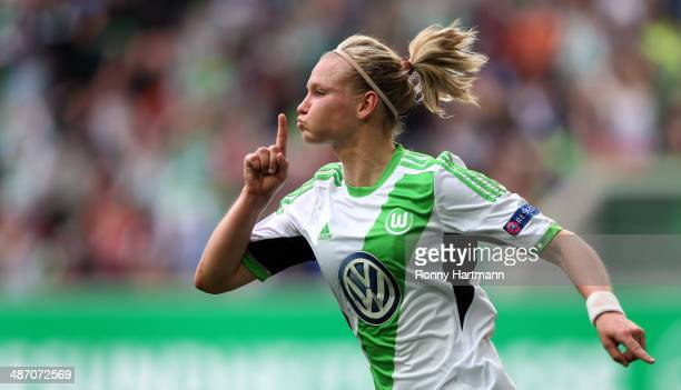 Alexandra Popp of Wolfsburg celebrates her team's second goal with team mates during the second UEFA Women's Champions League semi final match...