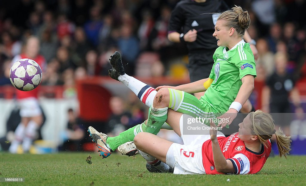 Alexandra Popp of Wolfsburg is tackled by Arsenal's Gilly Flaherty during the UEFA Women's Champions League Semi Final First Leg match between Arsenal Ladies and VFL Wolfsburg at Meadow Park on April 14, 2013 in Borehamwood, England.
