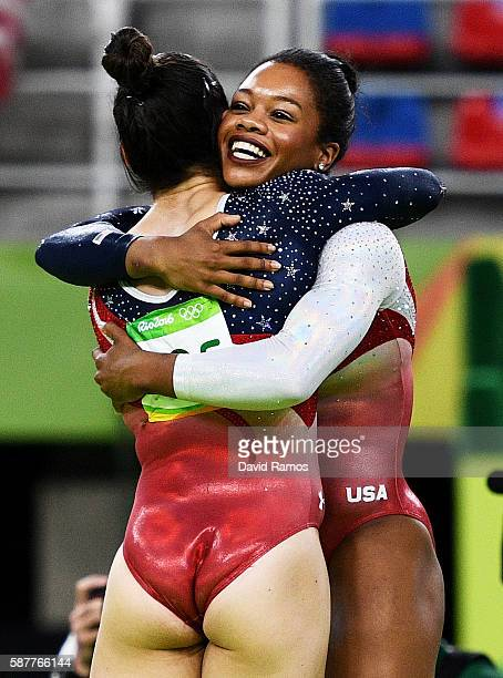 Alexandra Raisman and Gabrielle Douglas of the United States celebrate winning the gold medal during the Artistic Gymnastics Women's Team Final on...