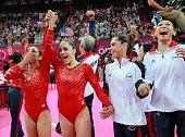 Alexandra Raisman Jordyn Wieber Mc Kayla Maroney and Kyla Ross of the United States celebrate during the final rotation in the Artistic Gymnastics...