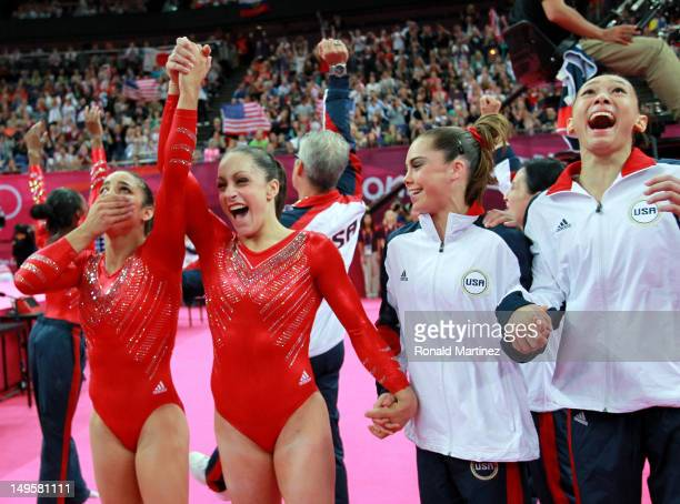 Alexandra Raisman Jordyn Wieber Mc Kayla Maroney and Kyla Ross of the United States celebrate during the final rotation in the Artistic Gymnastics...