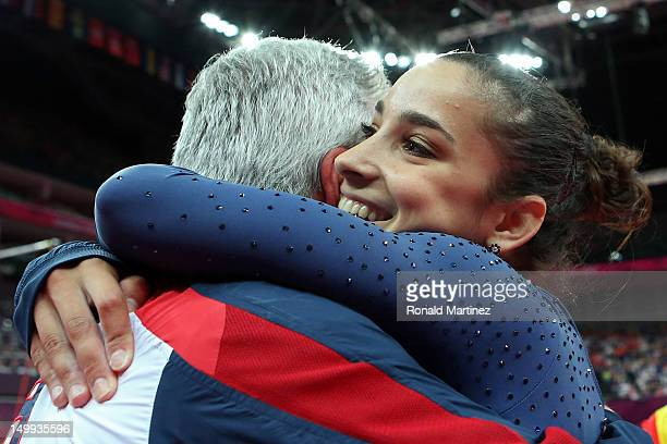 Alexandra Raisman of the United States hugs coach Mihai Brestyan after winning the gold medal for the Artistic Gymnastics Women's Floor Exercise...