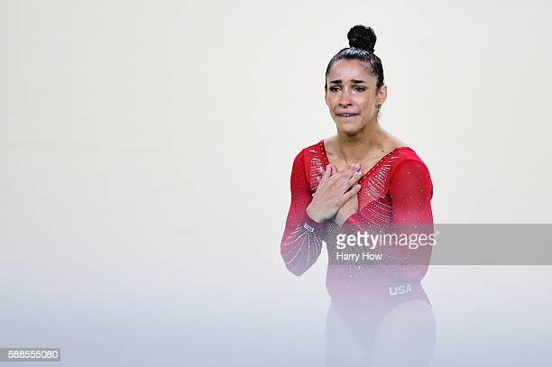 Alexandra Raisman of the United States reacts after competing on the floor during the Women's Individual All Around Final on Day 6 of the 2016 Rio...