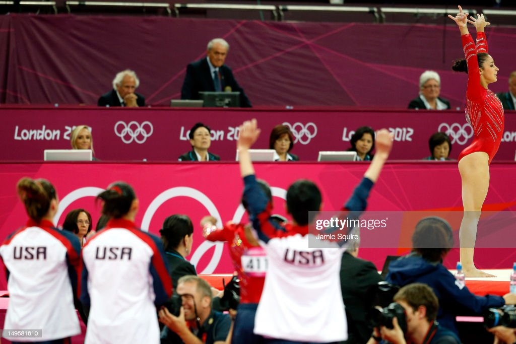 <a gi-track='captionPersonalityLinkClicked' href=/galleries/search?phrase=Alexandra+Raisman&family=editorial&specificpeople=7138858 ng-click='$event.stopPropagation()'>Alexandra Raisman</a> of the United States reacts after her floor exercise as her teammates cheer her on in the Artistic Gymnastics Women's Team final on Day 4 of the London 2012 Olympic Games at North Greenwich Arena on July 31, 2012 in London, England.