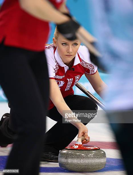 Alexandra Saitova of Russia competes during the Curling Women's Round Robin match between Russia and Great Britain on day ten of the Sochi 2014...