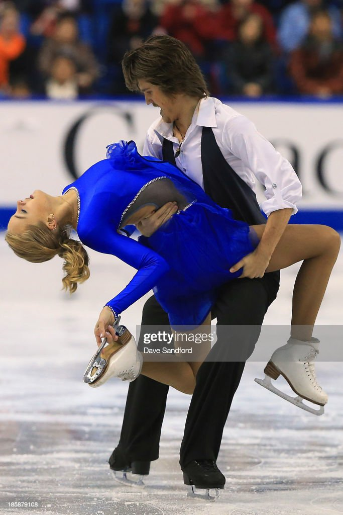 Alexandra Stepanova (L) and Ivan Bukin of Russia skate during the ice dance short program at the ISU GP 2013 Skate Canada International at Harbour Station on October 25, 2013 in Saint John, New Brunswick, Canada.