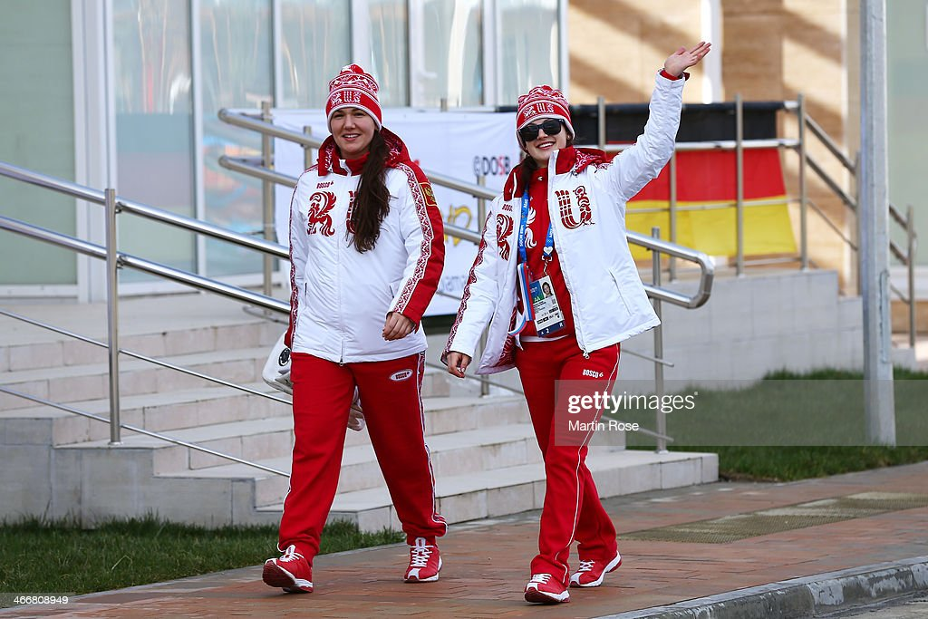 Alexandra Vafina of Russia (R) waves as she walks with a fellow team member ahead of the Sochi 2014 Winter Olympics at the Athletes Olympic Village on February 4, 2014 in Sochi, Russia.