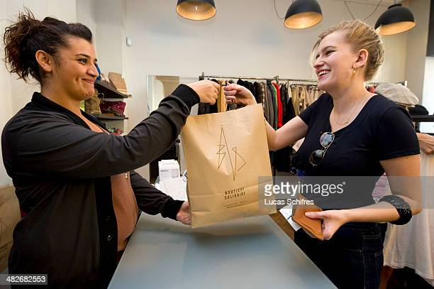 Alexandra Waldhorn pays 38 euros for her purchases to cashier Hajer Abdelhedi in BIS store which Alexandra calls her 'favorite store' on September 24...