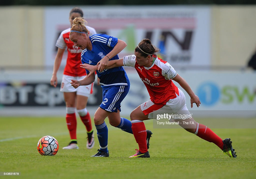 Alexandra Windell of Birmingham City Ladies is tackled by Emma Mitchell of Arsenal Ladies FC during the WSL match between Birmingham City Ladies and Arsenal Ladies FC at Automated Technology Stadium on June 29, 2016 in Solihull, England.