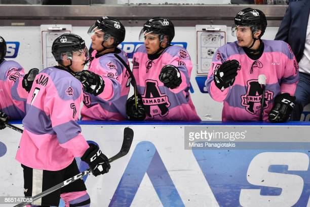 Alexandre Alain of the BlainvilleBoisbriand Armada celebrates his second period goal with teammates on the bench against the Quebec Remparts during...