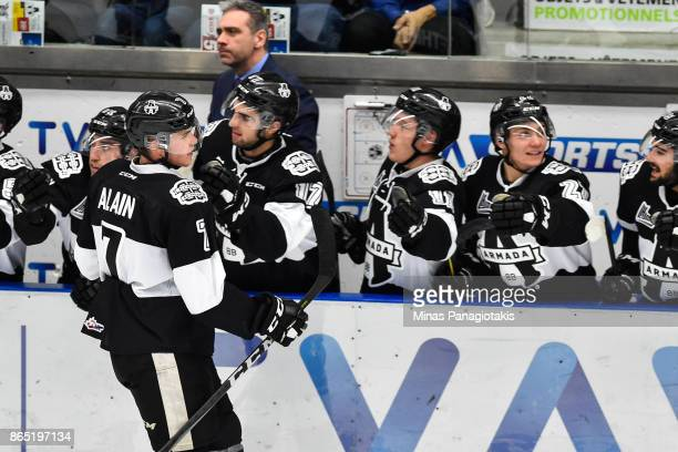 Alexandre Alain of the BlainvilleBoisbriand Armada celebrates his second period goal with teammates on the bench against the Halifax Mooseheads...