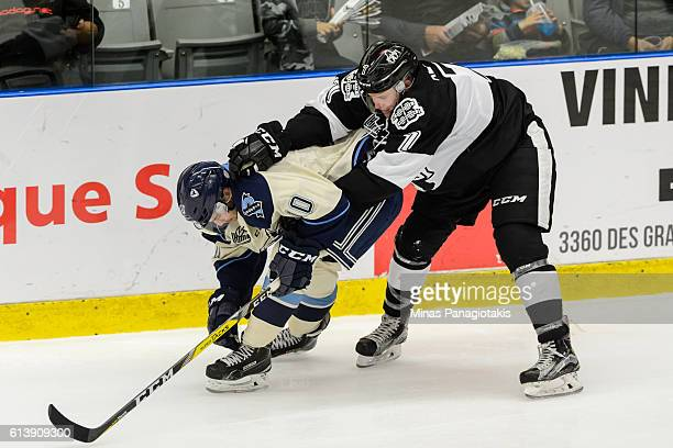 Alexandre Alain of the BlainvilleBoisbriand Armada challenges Kevin Gilbert of the Sherbrooke Phoenix during the QMJHL game at the Centre...