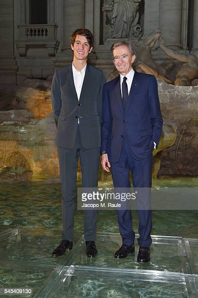 Alexandre Arnault and Bernard Arnault attend the Fendi Roma 90 Years Anniversary fashion show at Fontana di Trevi on July 7 2016 in Rome Italy