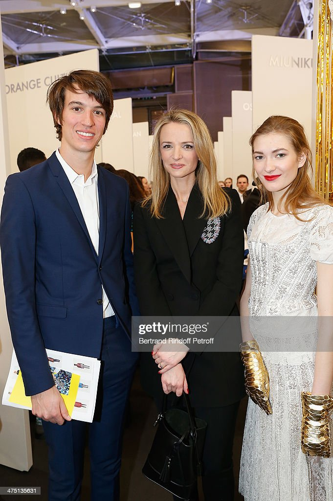 Alexandre Arnault, Delphine Arnault and a model attend LVMH Prize Semi-Finalists Designers Cocktail Party on February 26, 2014 in Paris, France.