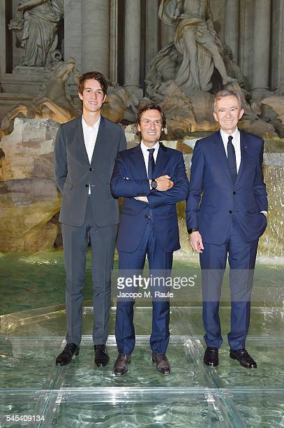 Alexandre Arnault Pietro Beccari and Bernard Arnault attend the Fendi Roma 90 Years Anniversary fashion show at Fontana di Trevi on July 7 2016 in...