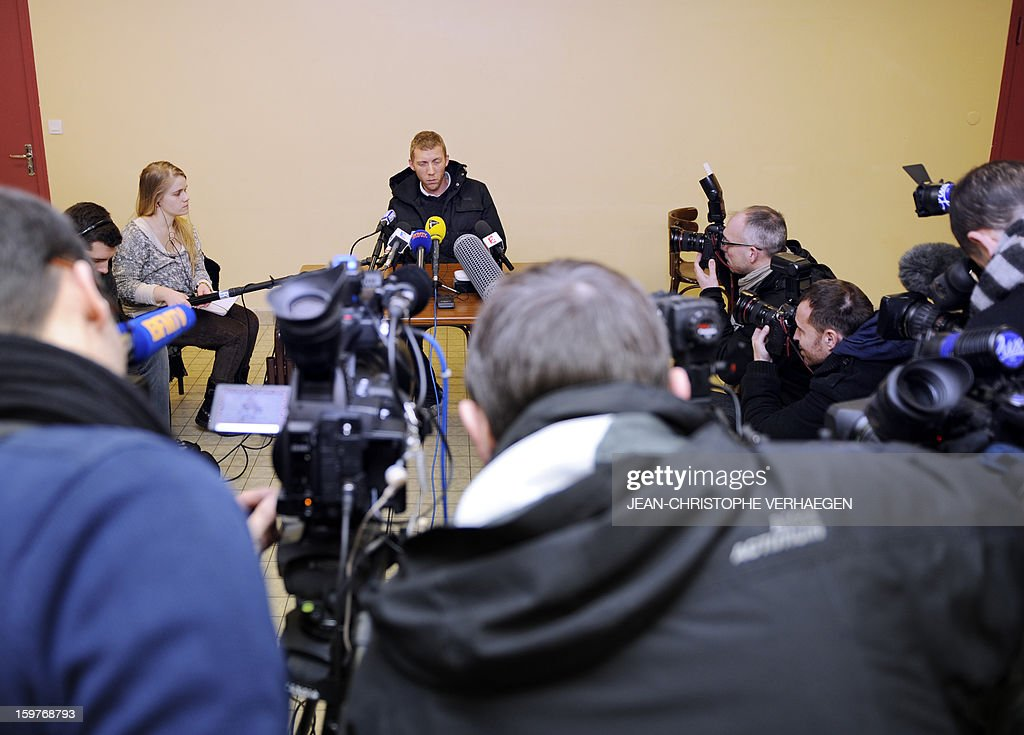 Alexandre Berceaux (C), a French ex-hostage in Algeria, speaks to journalists on January 20, 2013 in Pagny-sur-Moselle, eastern France. Berceaux succeeded with other Algerian and foreigners to escape on January 17 from the Tiguentourine gas field in southeastern Algeria. The fate of some 30 foreigners hung in the balance today after Al-Qaeda-linked hostage-takers at a remote Algerian gas field demanded a prisoner swap and an end to French military action in Mali.