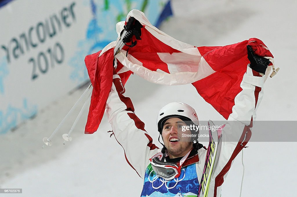 Alexandre Bilodeau of Canada celebrates winning the gold medal during the flower ceremony for the Freestyle Skiing Men's Moguls on day 3 of the 2010...