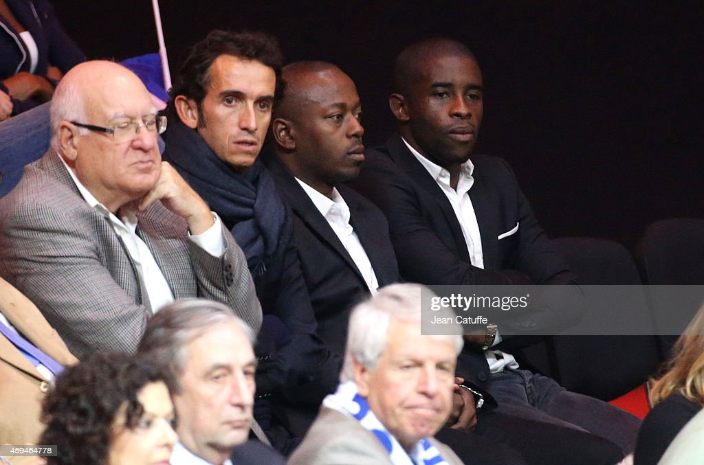 Alexandre Bompard, <a gi-track='captionPersonalityLinkClicked' href=/galleries/search?phrase=Rio+Mavuba&family=editorial&specificpeople=708351 ng-click='$event.stopPropagation()'>Rio Mavuba</a> (R) attend day three of the Davis Cup tennis final between France and Switzerland at the Grand Stade Pierre Mauroy on November 23, 2014 in Lille, France.