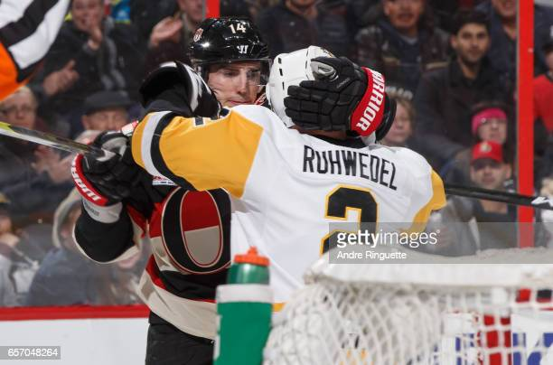Alexandre Burrows of the Ottawa Senators and Chad Ruhwedel of the Pittsburgh Penguins grab at each other during a scrum at Canadian Tire Centre on...